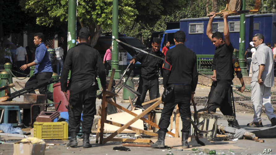 Egyptian riot police smash furniture and other items as they clear Tahrir Square in Cairo, Egypt, September 15, 2012.
