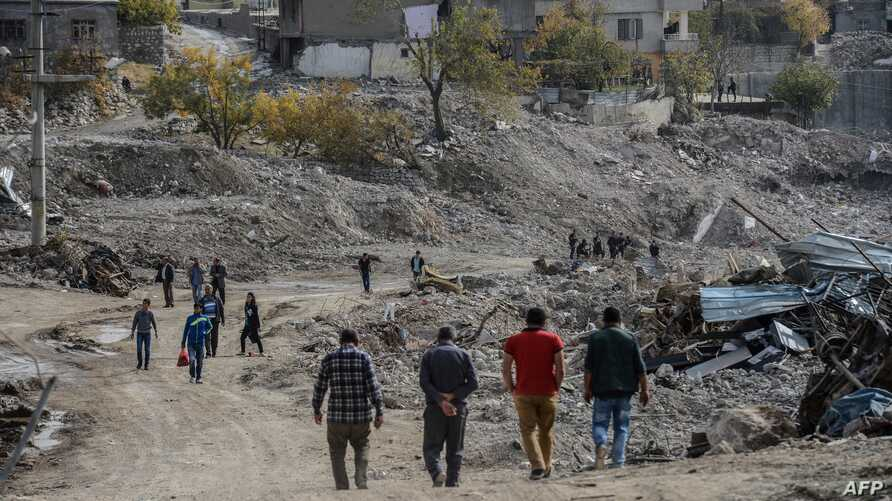 FILE - People arrive in Sirnak city on Nov. 14, 2016, after a 246-day curfew was partially lifted. The curfew in Sirnak, a city of 290,000, was imposed on March 14 as part of operations to eradicate the PKK from eastern Turkey.