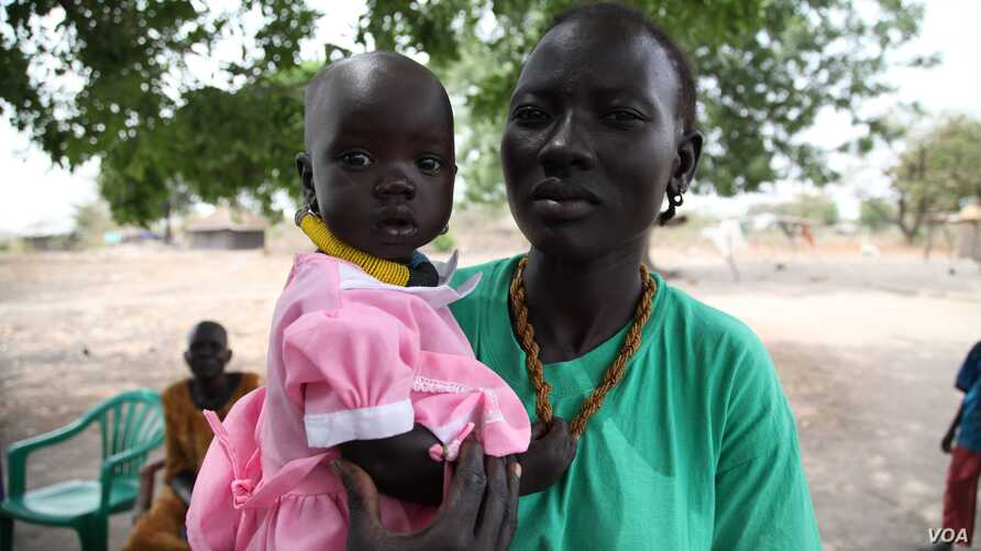 Members say the bank has made it possible to pay for their children's education and medical fees, Rumbek, Lakes State, South Sudan, Jan. 30, 2013. (H. McNeish/VOA)