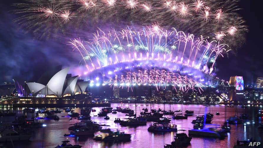 New Year's Eve fireworks erupt over Sydney's iconic Harbour Bridge and Opera House in Australia, during the fireworks show, Jan. 1, 2019.