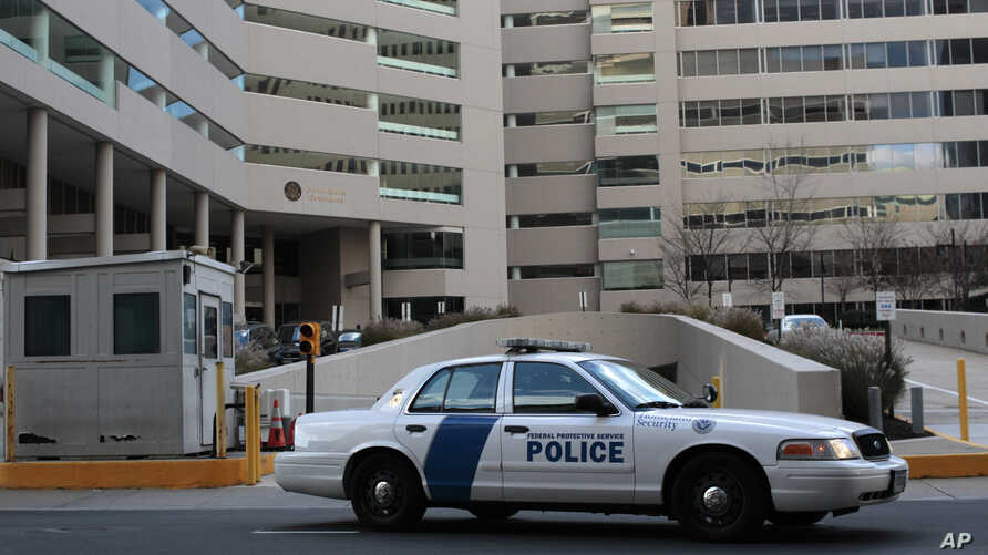FILE - A federal law enforcement vehicle sits in front of the United State Courthouse in Baltimore.