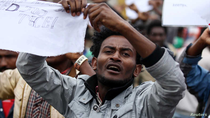 A protester chants slogans during a demonstration over what they say is unfair distribution of wealth in the country at Meskel Square in Ethiopia's capital, Addis Ababa, Aug. 6, 2016.