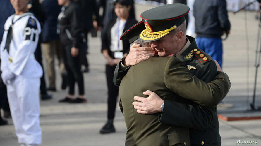 Unidentified members of the Navy embrace as they stand alongside relatives of the 44 crew members of the missing at sea ARA San Juan submarine during a ceremony to commemorate the one year anniversary of the tragedy in Mar del Plata, Argentina, Nov.