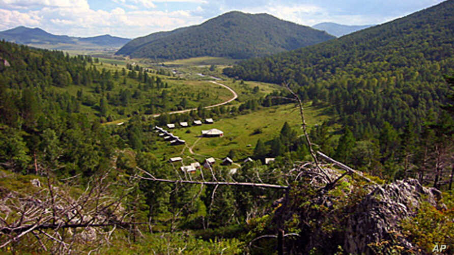View from a rock above Denisova cave on to the excavation field camp
