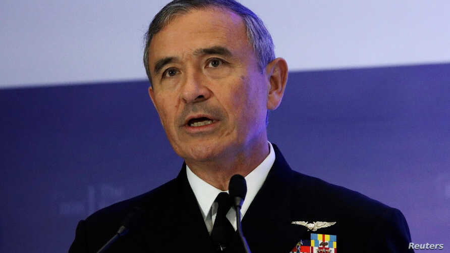 FILE - U.S. Navy Admiral Harry Harris Jr, head of the Pacific Command, speaks at a Fullerton Lecture on 'Challenges, Opportunities and Innovation in the Indo-Asia-Pacific,' in Singapore, Oct. 17, 2017.