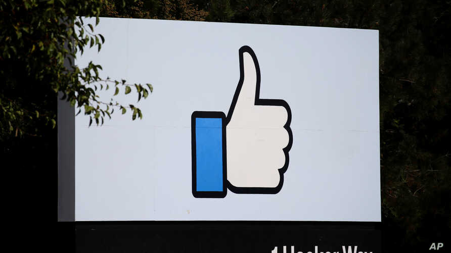 FILE - The entrance sign to Facebook headquarters is seen in Menlo Park, California.