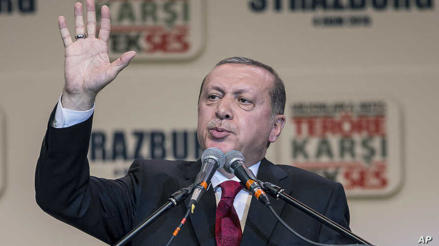 FILE - Turkey's President Recep Tayyip Erdogan gestures as he speaks to supporters of his ruling Justice and Development Party as they rally to denounce violence by Kurdish rebels, in Strasbourg, eastern France, Oct. 4, 2015.