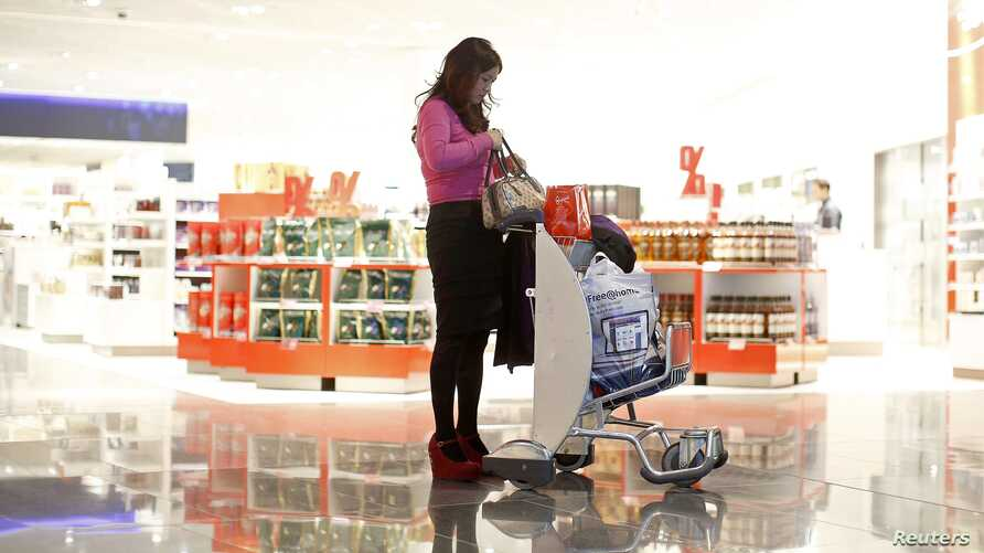 A woman from China at a Duty Free store that offers new Mandarin-speaking personal shopper service, Fraport airport, Frankfurt, Nov. 14, 2012.