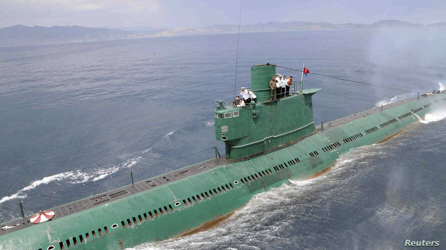 FILE - North Korean leader Kim Jong Un (L) stands on the conning tower of a submarine during his inspection of the Korean People's Army (KPA) Naval Unit 167 in this undated photo released by North Korea's Korean Central News Agency (KCNA) in Pyongyan