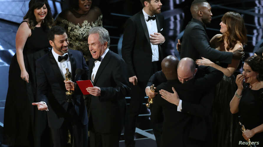 Jimmy Kimmel and Warren Beatty laugh after correcting the Best Picture Oscar from La La Land to Moonlight.