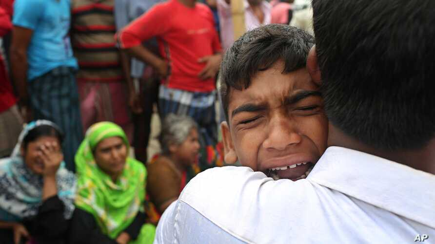 A Bangladeshi boy cries for his mother, missing after a ferry they were travelling in capsized in the River Padma in Munshiganj district, Aug. 5, 2014.
