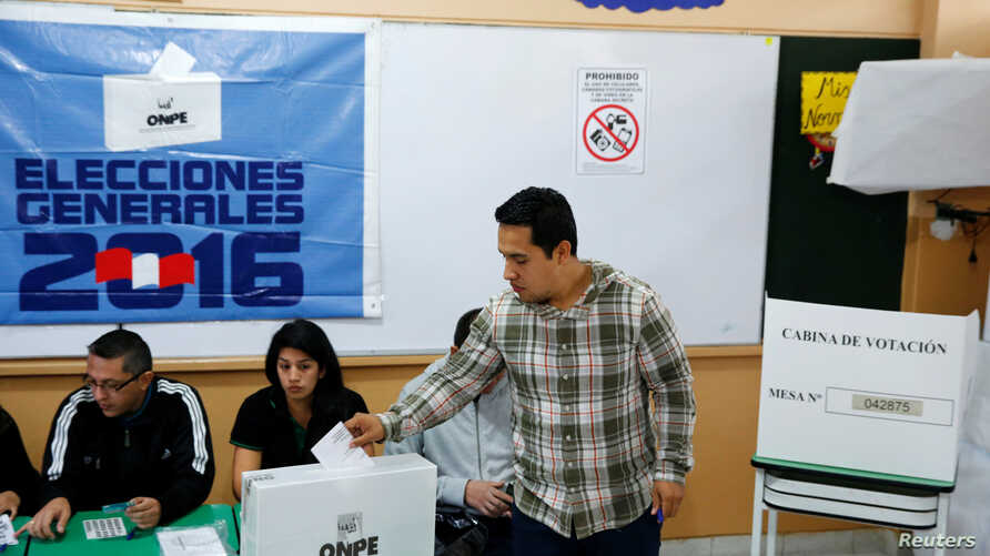 A man casts his ballot in Peru's presidential election at a voting station in Lima, Peru, June 5, 2016.