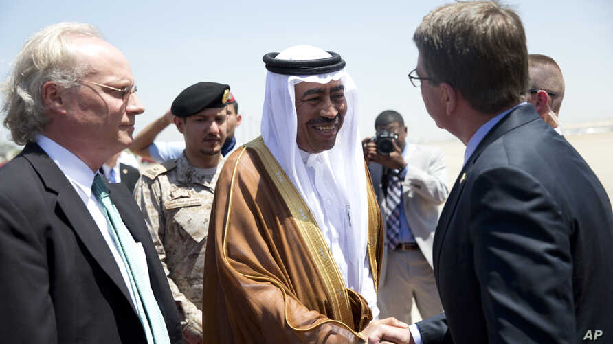 U.S. Defense Secretary Ash Carter, right, is greeted by Saudi Arabian Assistant Minister of Defense Mohammad Al-Ayesh, center, as Tim Lenderking U.S. Embassy Deputy Chief of Mission stands left, after his arrival in Jiddah, Saudi Arabia, July 22, 201