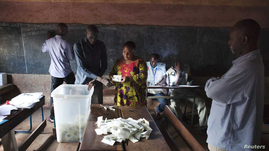Poll workers count ballots in Bamako, Aug. 11, 2013.