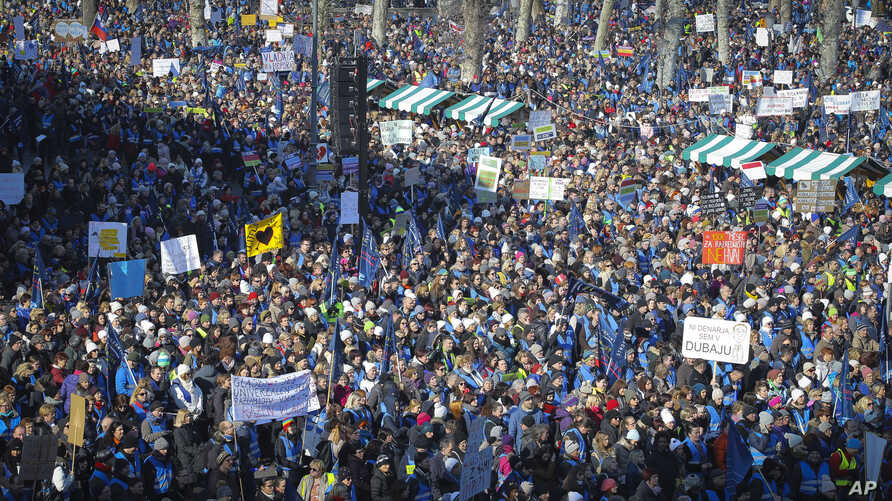 Thousands gather during a trade unions rally in downtown Ljubljana, Slovenia, Feb. 14, 2018.