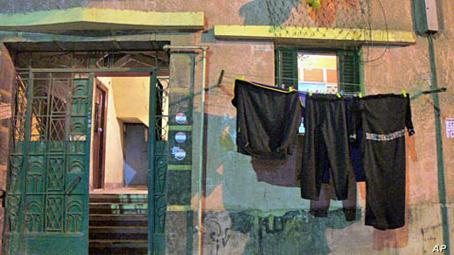 The ground floor apartment of Ahmed Shaban, whose death is linked to police at an Alexandria police station, is distinguished by the black mourning clothes hanging  outside, 22 Nov 2010