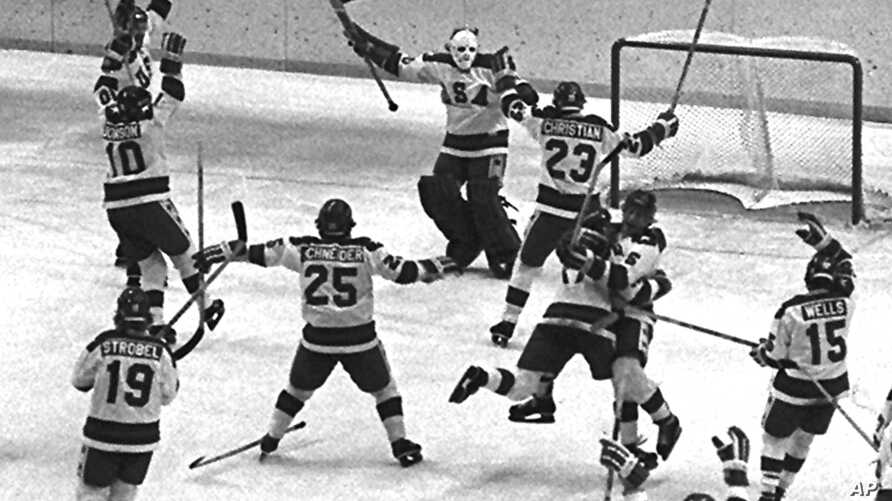 The 1980 U.S. Olympic hockey team members celebrate after their upset victory over the heavily favored Soviet team by 4-3 score in the Winter Olympics in Lake Placid, N.Y., on Feb. 22, 1980.