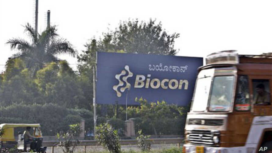 Traffic moves outside the main premises of Biocon, an Indian biotech company, in Bangalore, India, 17 Dec 2010