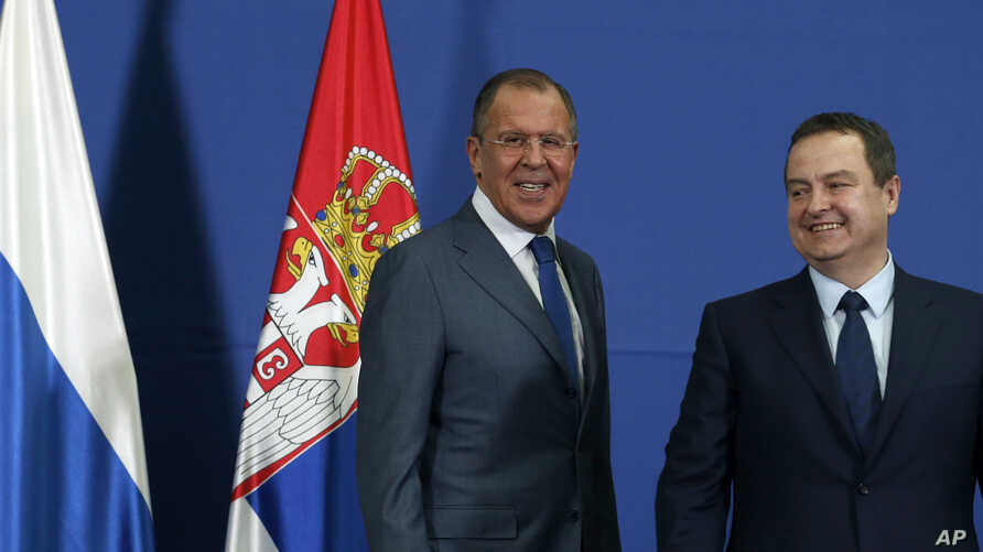 Russian Foreign Minister Sergey Lavrov, smiles during an appearance  with his Serbian counterpart Ivica Dacic (right) in Belgrade, Serbia, Monday, Dec. 12, 2016. Lavrov is on a two-day official visit to Serbia.