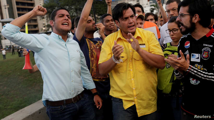 FILE - Lawmakers from the Venezuelan coalition of opposition parties Jose Manuel Olivares (L), Carlos Paparoni (C) and Miguel Pizarro attend a candlelight rally to pay tribute to victims of violence during protests against Venezuelan President Nicola