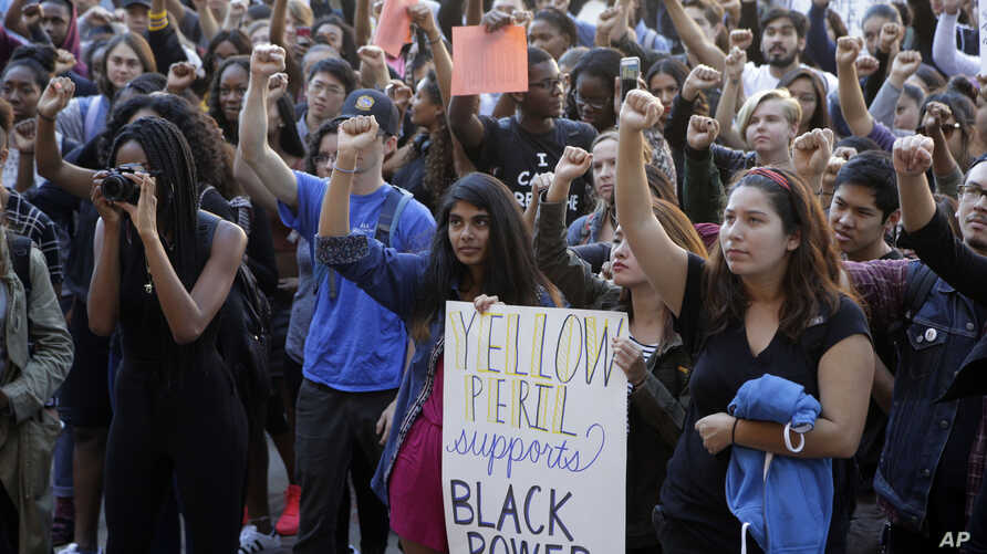 University California Los Angeles students stage a protest rally in a show of solidarity with protesters at the University of Missouri, in Los Angeles, Nov. 12, 2015,