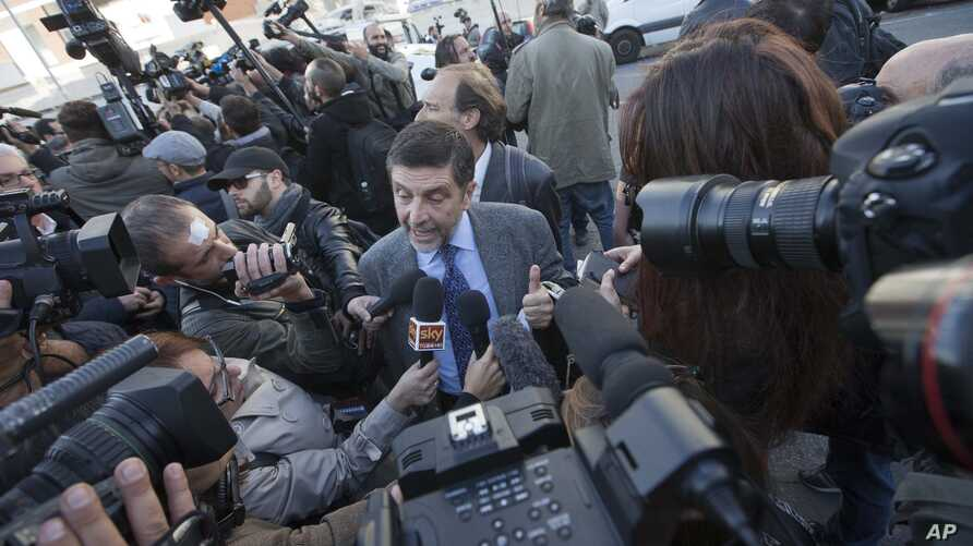 Massimo Carminati lawyer, Bruno Naso is chased by reporters as he arrives at a court in Rome, Nov. 5, 2015.