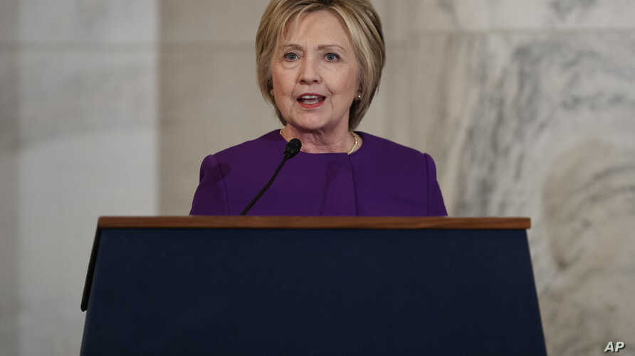 Former Secretary of State Hillary Clinton speaks during a ceremony to unveil a portrait of Senate Minority Leader Harry Reid, D-Nev., on Capitol Hill, Dec. 8, 2016, in Washington.