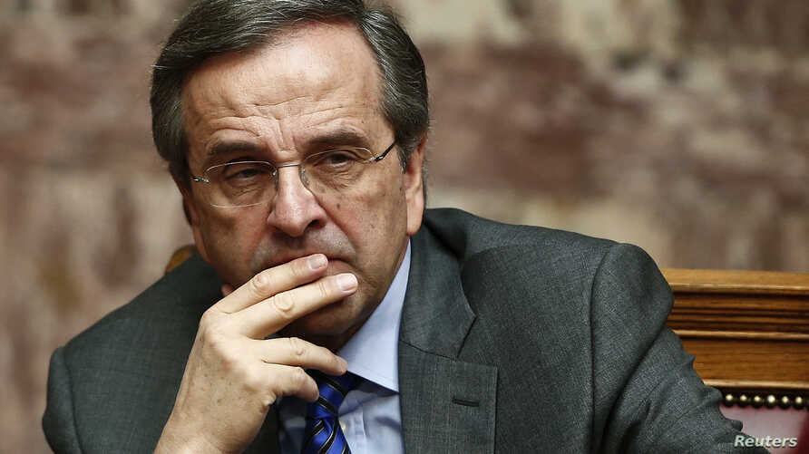 Greece's Prime Minister Antonis Samaras reacts during the second of three rounds of a presidential vote at the Greek parliament in Athens, December 23, 2014.
