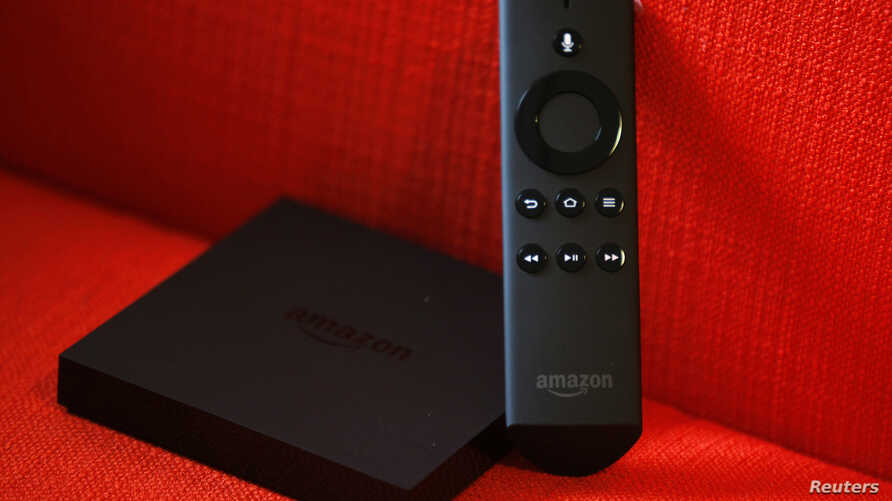 FILE - An Amazon Fire TV set is seen on a couch after a news conference in New York, April 2, 2014.