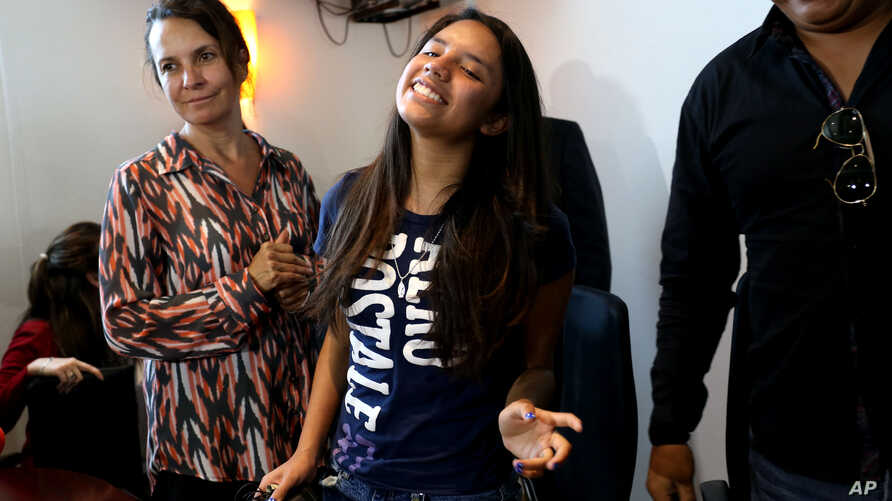 Alondra Luna Nunez, 14, smiles after attending a press conference upon her arrival to the Guanajuato International Airport in Silao, Mexico, April 22, 2015.