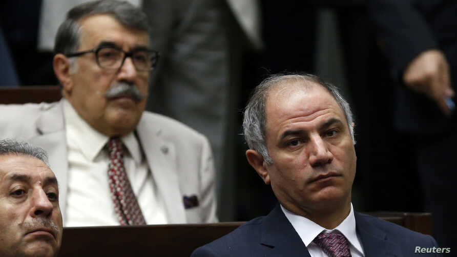 Turkey's Interior Minister Efkan Ala (R) attends a meeting at the Turkish parliament in Ankara. Dozens of police including high-ranking officers were detained in Turkey, accused of spying and illegal wire-tapping of Prime Minister Tayyip Erdogan and