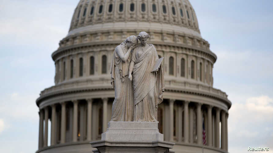The statue of Grief and History stands in front of the Capitol Dome in Washington October 15, 2013. Stop-start negotiations to end the U.S. fiscal impasse left congressional leaders and President Barack Obama desperately searching on Tuesday for a wa