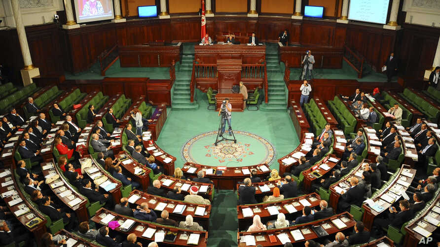 FILE - Lawmakers are seen assembled in Tunisia's parliament in Tunis, Dec. 2, 2014.