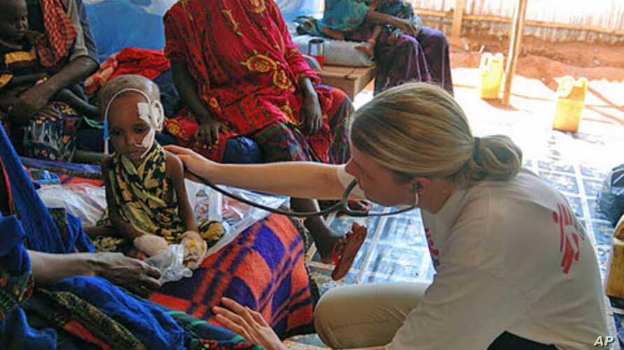 Dr. Monica Thallinger treats a severely malnourished child at the Phase Two emergency ward of the Doctors Without Borders health clinic at Hilaweyn refugee camp, Dollo Ado, Ethiopia, October 26, 2011.