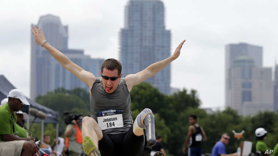 Eric Johnson competes in the men's long jump during the U.S. Paralympics Team Trials in Charlotte, N.C., July 1, 2016.