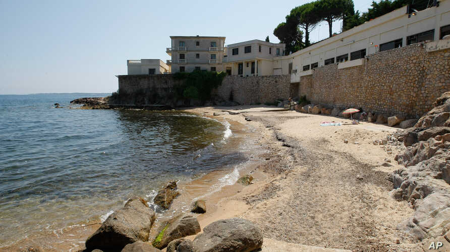 """A view of the public beach called """"La Mirandole"""" located below a mansion owned by the Saudi royal family in Golfe Juan Vallauris, southern France, July 17, 2015."""