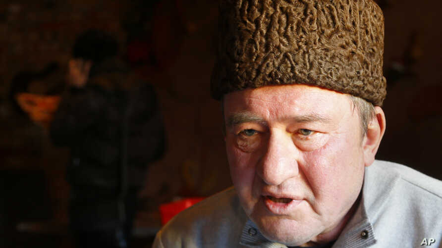 FILE - In this photo taken on Monday, Jan. 25, 2016, a Crimean Tatar leader, Ilmi Umerov, speaks during an interview to the Associated Press in Simferopol, Crimea. An international rights group has urged Russia to release Umerov who has been sent to