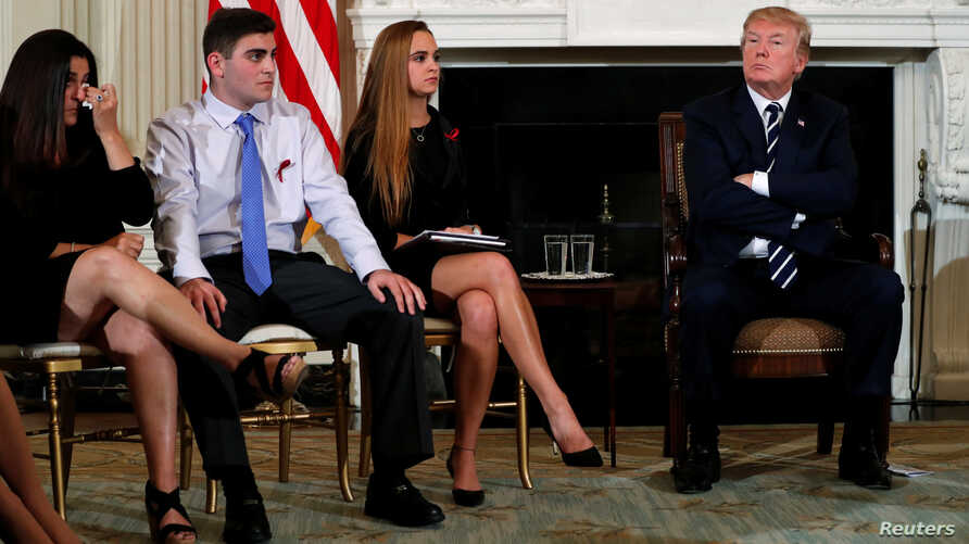 Parent Melissa Blank, from left, and Marjory Stoneman Douglas High School shooting surviving students Jonathan Blank and Julia Cordover attend with other survivors and the families of victims a listening session held by U.S. President Donald Trump to