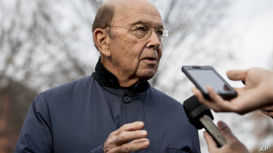 FILE - Commerce Secretary Wilbur Ross speaks to reporters outside the White House in Washington.