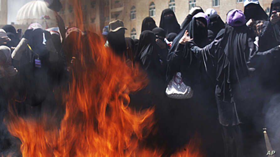 Female Yemeni protesters burn veils during a demonstration demanding the resignation of Yemeni President Ali Abdullah Saleh in Sana'a, Yemen, October 26, 2011.