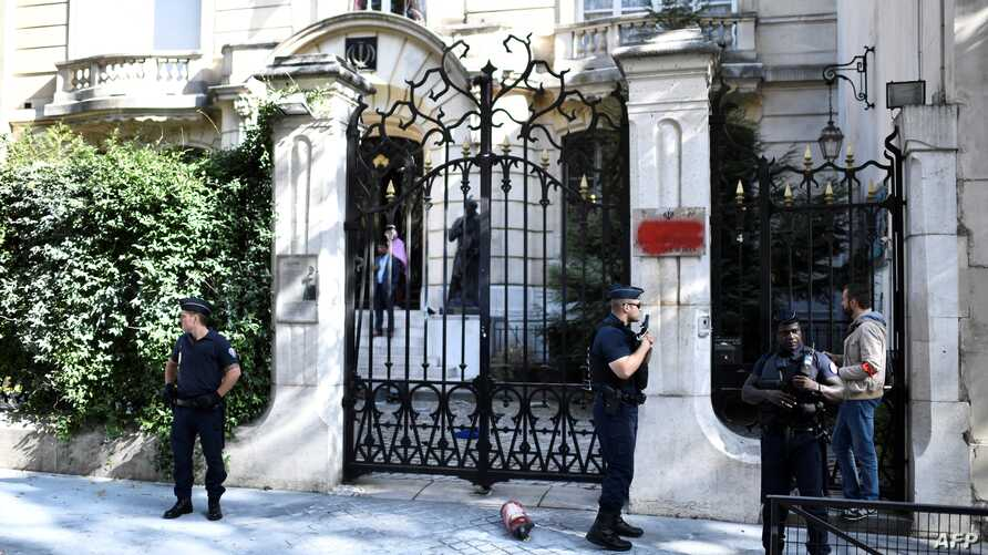 FILE - French police stand guard outside the Iranian Embassy in the French capital Paris on Sept. 14, 2018 following a demonstration nearby.
