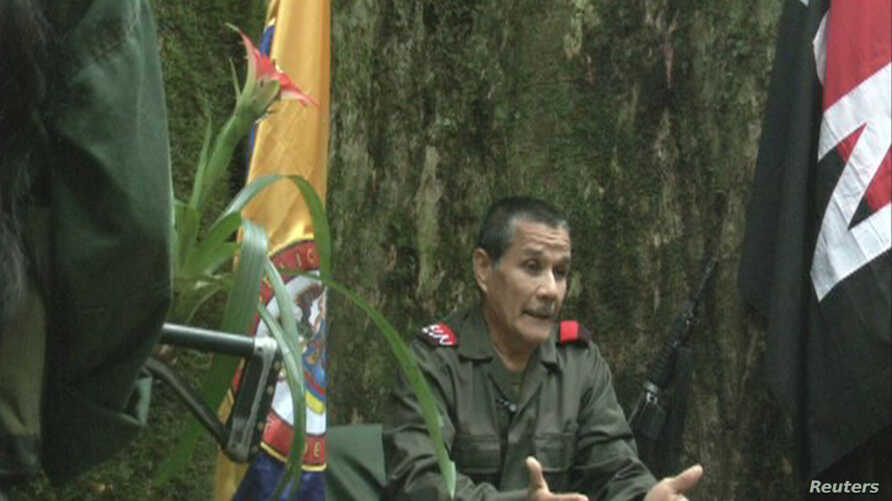 "FILE - Colombian guerrilla group National Liberation Army (ELN) commander Nicolas Rodriguez, known as ""Gabino,"" gestures as he speaks in response to questions from Reuters at a hidden jungle camp in this still image taken from an undated video releas"