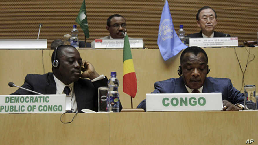 Front row, left to right,  Joseph Kabila Kabange President of the Democratic Republic of Congo, and Denis Sanssou N'guesso, President of the Republic of Congo, during the signing of the Congo peace deal in Addis Ababa, Ethiopia,  Feb. 24, 2013.