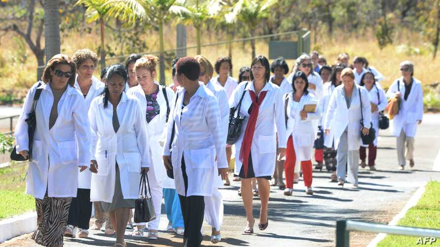 Foreign physicians — mainly Cuban — arrive at the Universi