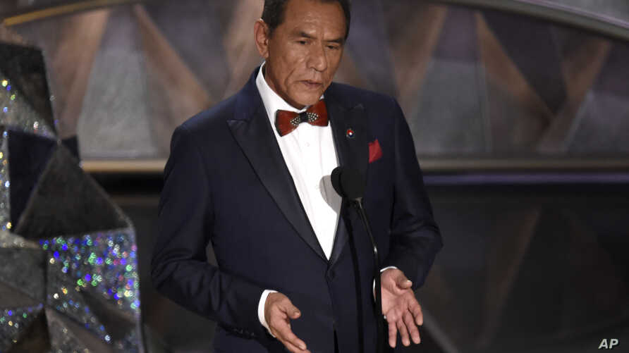 Wes Studi introduces a tribute to films that honor service in the military at the Oscars on Sunday, March 4, 2018, at the Dolby Theatre in Los Angeles.