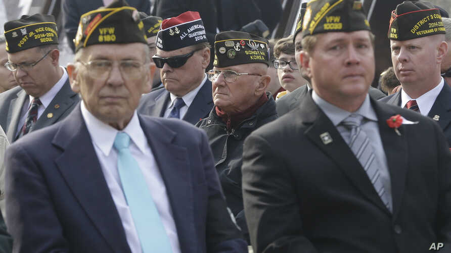 U.S. veterans, who fought in foreign wars, attend a U.S. Veteran's Day Ceremony at Yongsan Garrison, the main U.S. military headquarters in Seoul, South Korea, Tuesday, Nov. 11, 2014.