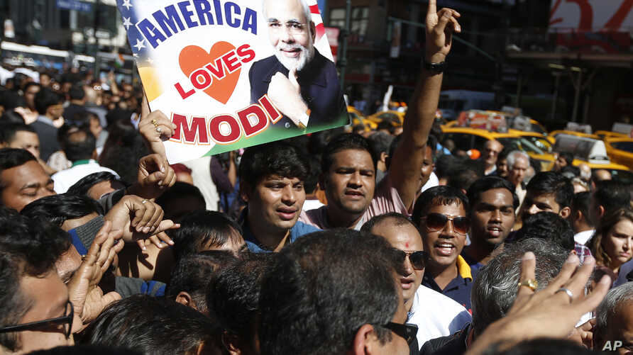 Supporters of Prime Minister Narendra Modi of India crowd the streets outside Madison Square Garden after Modi gave a speech there during a reception by the Indian community in honor of his visit to the United States, Sunday, Sept. 28, 2014.