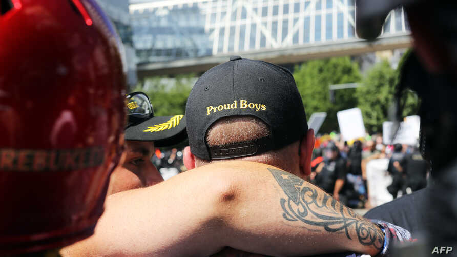 A person wears a hat of U.S. far-right men's organization Proud Boys during a campaign rally for Patriot Prayer founder and Republican Senate candidate Joey Gibson in Portland, Oregon, Aug. 4, 2018.