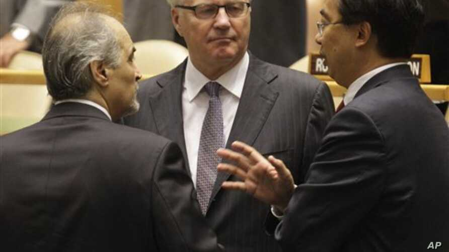 Syria's U.N. Ambassador Bashar Ja'afari (L), speaks to Russia's U.N. Ambassador Vitaly Churkin (C), and China's deputy U.N. Ambassador Wang Min before the United Nations General Assembly passed a draft resolution condemning Syria, at the United Natio