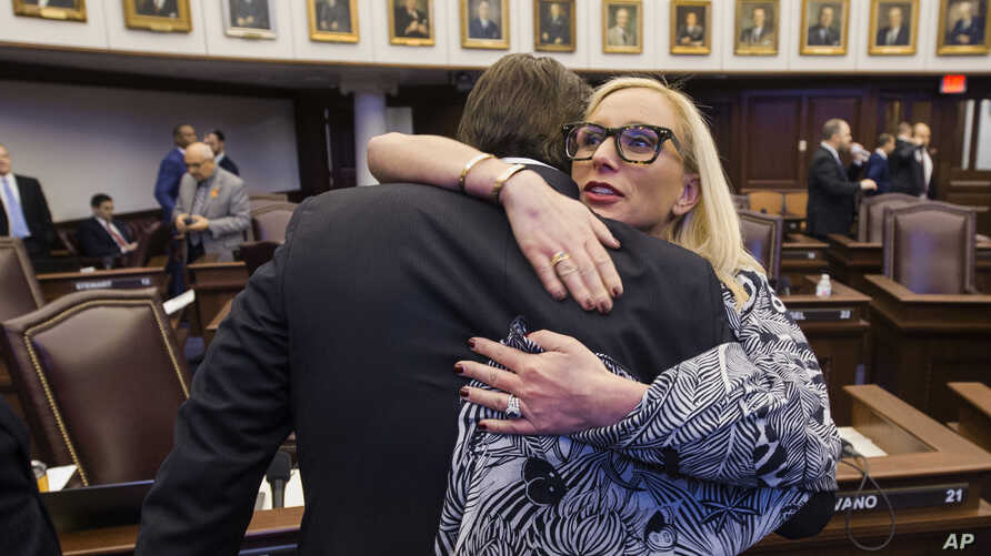 Florida Sen. Lauren Book, right, embraces Sen. Bill Galvano after Galvano's bill, the Marjory Stoneman Douglas High School Student Safety Act, passed 20-18 at the Florida Capitol in Tallahassee, Florida, March 5, 2018.